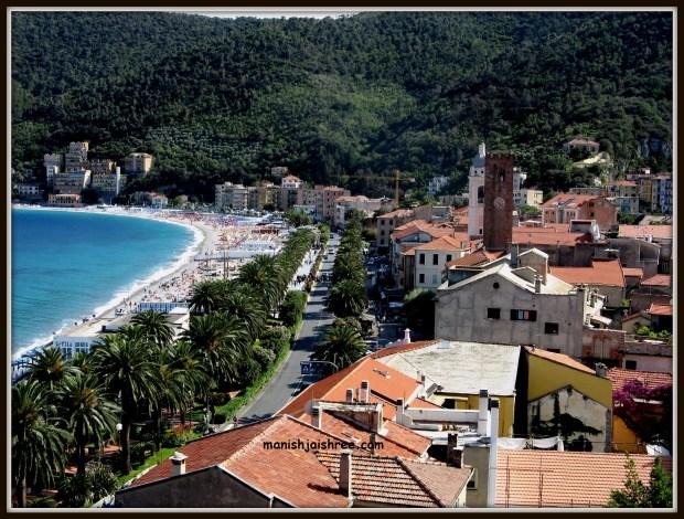 Noli town, palm fringed Courso Italia and a slice of sea