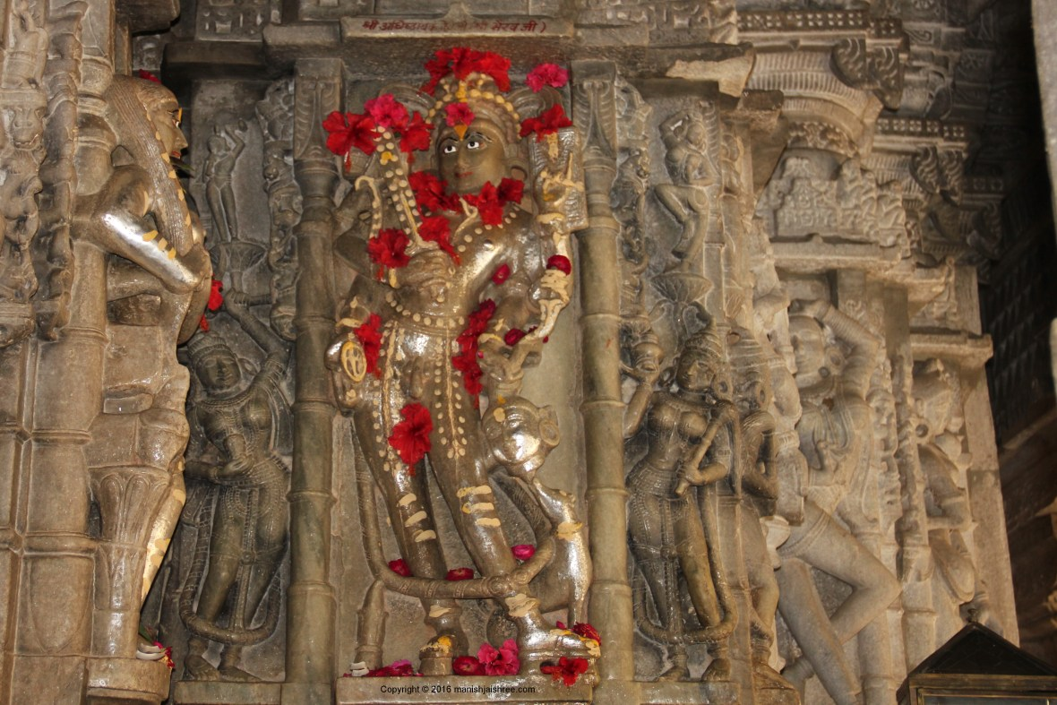 The main Yaksha of Lord Adinath, I am curious to know the name of the dev, note the head of a woman in his hand