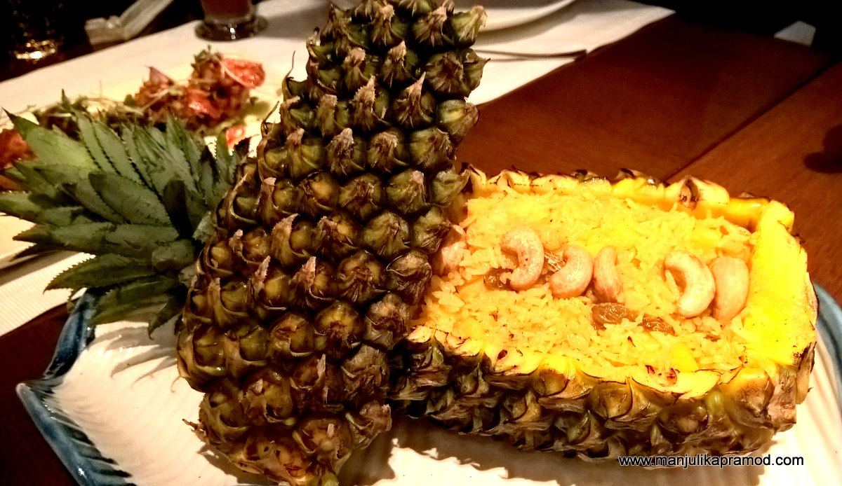Pineapple Rice served in an empty pineapple