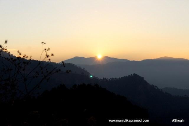 Sun rising behind the hills