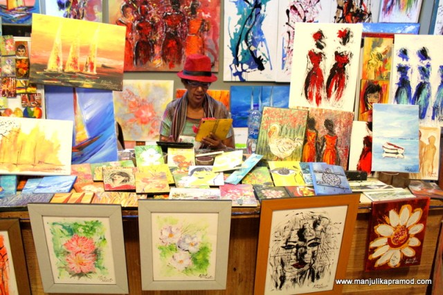 A local artist sitting at her painting shop - Mauritius
