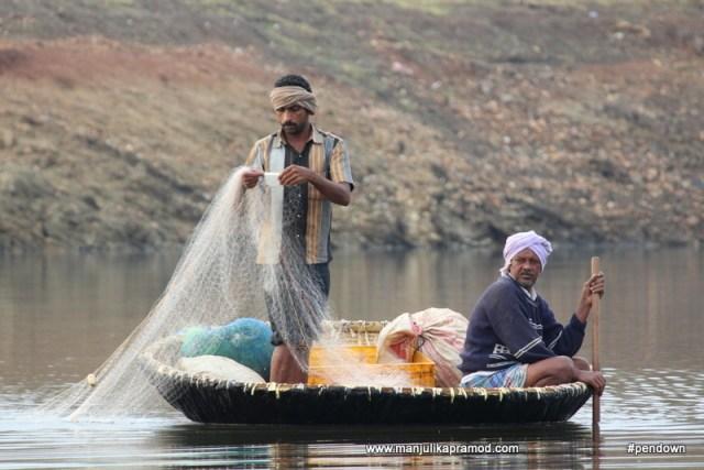 The fisherman throwing his fishing net.