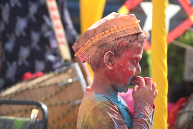 Picture of boy who has been colored with Gulal