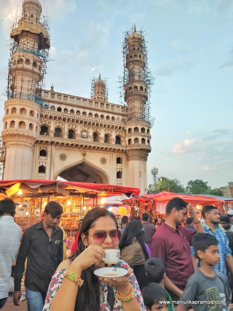 A girl having Iraani chai at Charminar