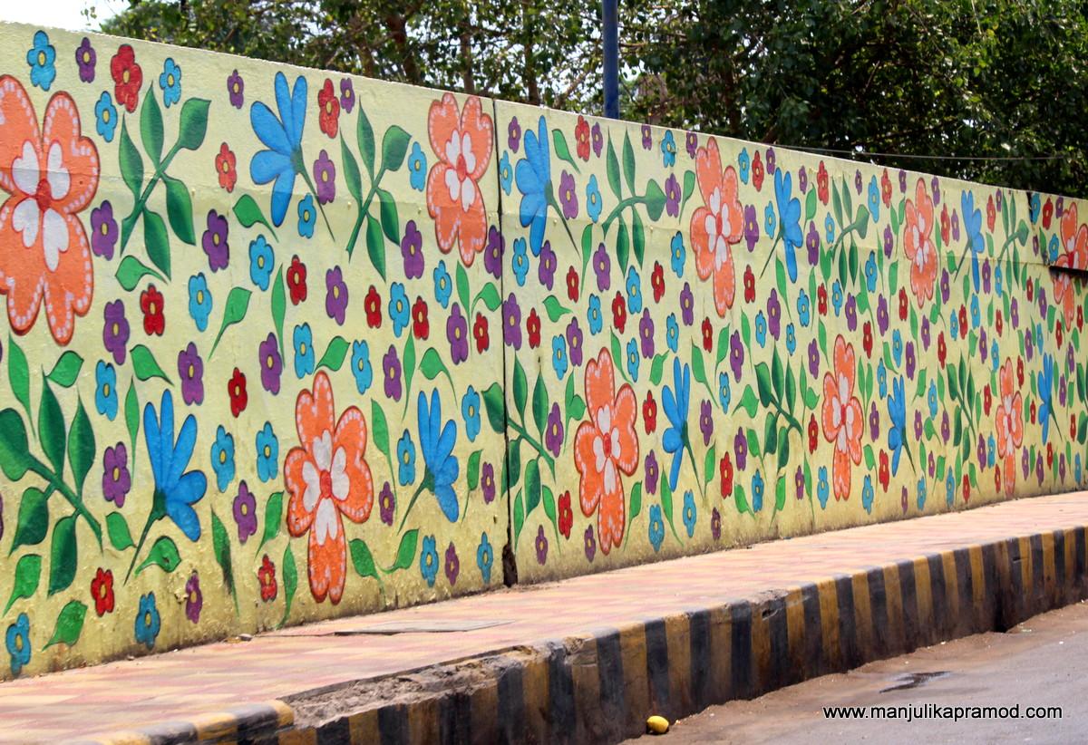 Painted flowers on the road - Vijayawada