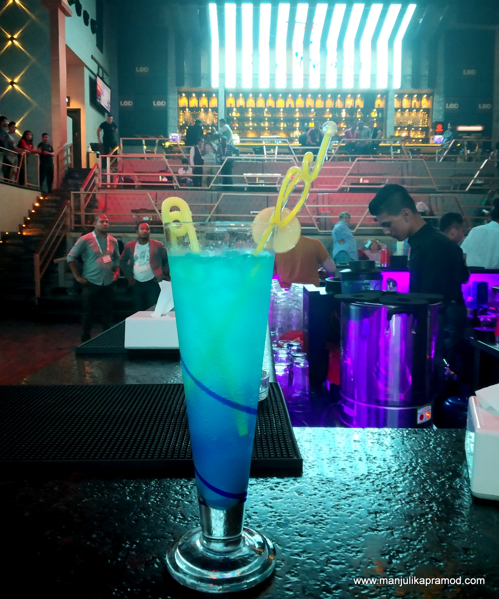 A glass of Blue lagoon in a pub