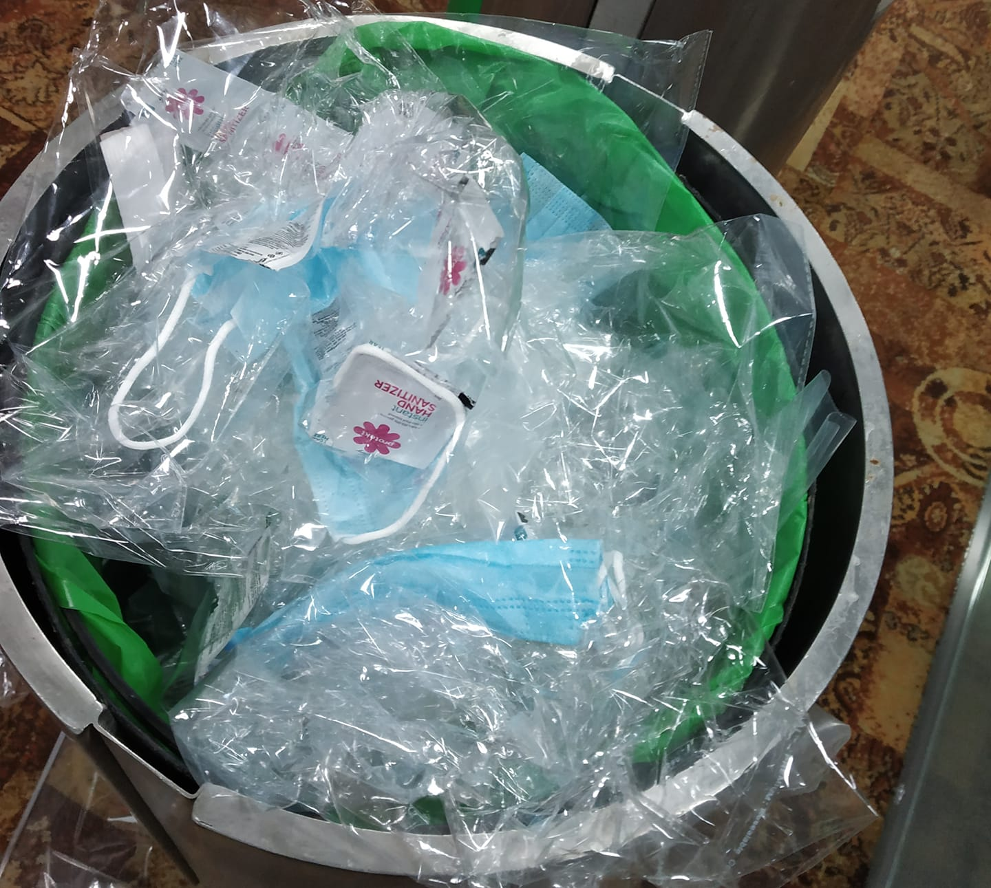 Masks and Sanitizers in a dustbin