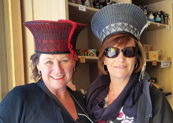 Mandy Morelli with EDKaren Nickels trying on some new headgear