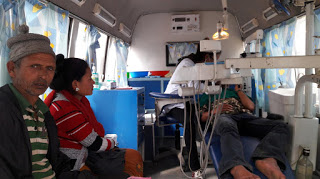 Fig 11: Scaling inside the mobile dental van.