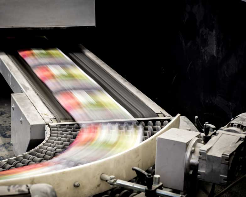 Image of an active catalogue printing machine during a print run