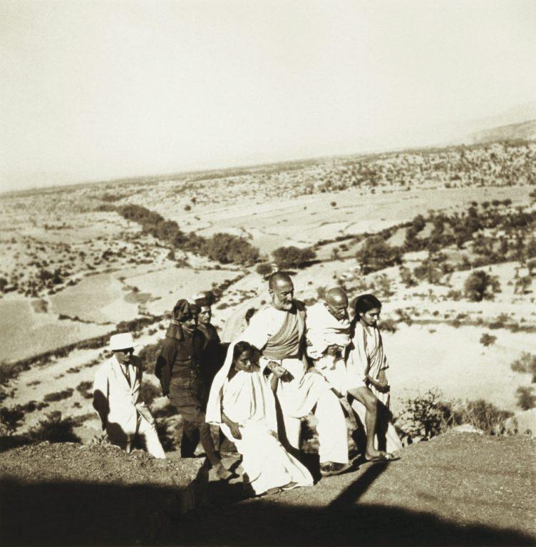 Dr. Sushila Nayar, Mahatma Gandhi, Khan Abdul Ghaffar Khan, Amtus Salam and others walking in the countryside, North West Frontier Province