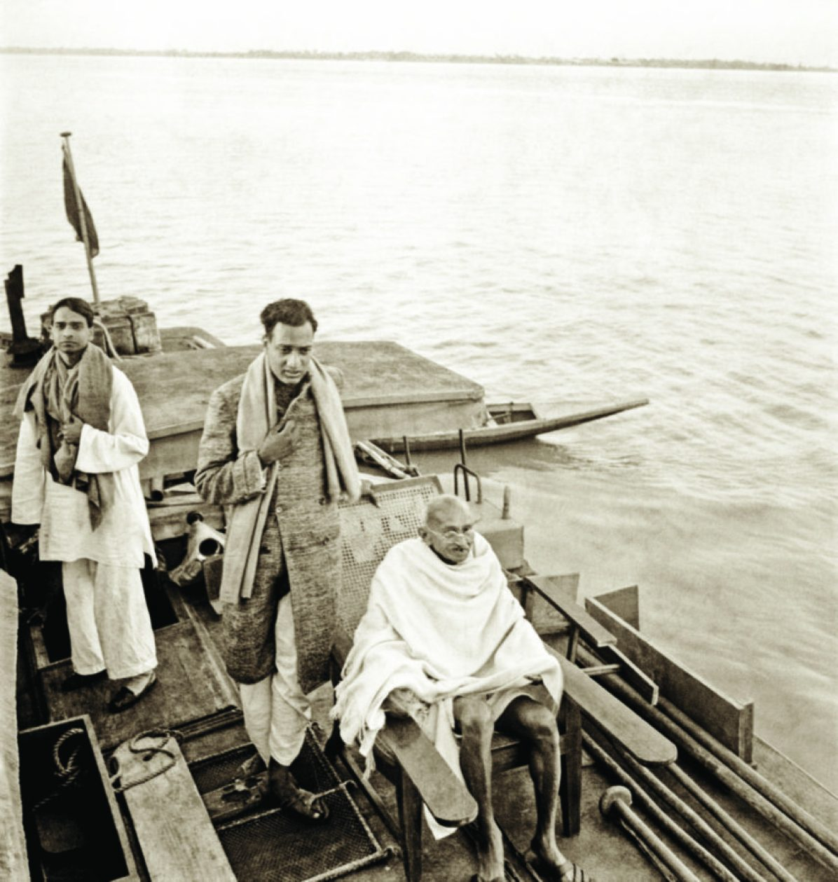 With Sudhir Ghosh and Ramkrishna Bajaj on a boat to Midnapur, East Bengal