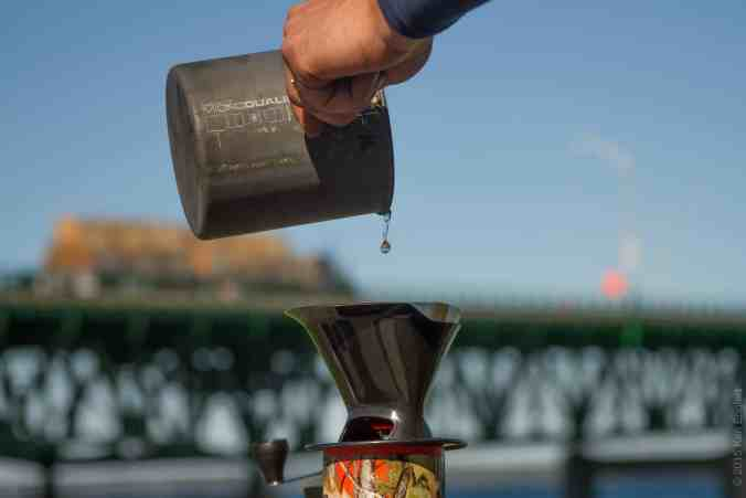 Brewing a cup of coffee on the beach near the Mackinaw Bridge (You can see some of the beach in the water drop)