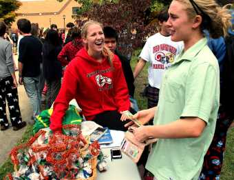 """Students sell """"puppy chow"""" to students at carnival. Photo by Mesa Serikali"""