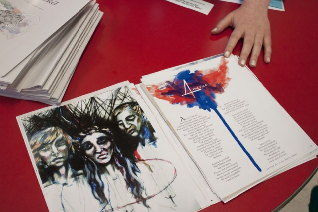 """An open page from """"Equinox"""" lies on the table, where audience members could preorder a copy. 