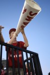 Patrick Frentz (12)  uses the megaphone to get the crowd and student section energized.