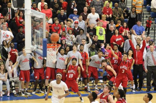 The Manual crowd anticipates a three from Chris West (#3). He misses and Jake Chilton (#34) grabs the rebound.
