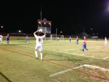 Riley Hook (12, #8) prepares for a throw in to run the clock out. Photo by Reagan Roy