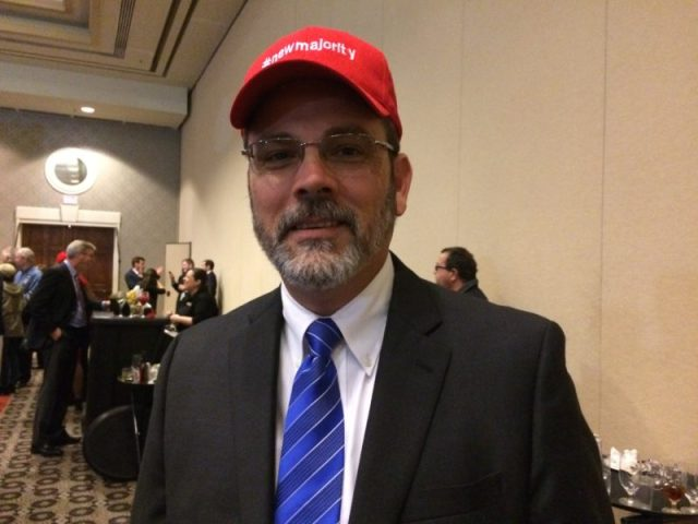 """State representative Ken Upchurch wears a hat that says """"a new majority."""""""