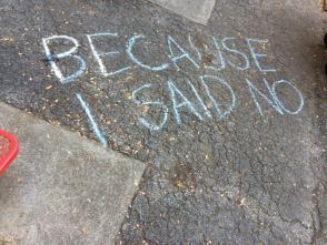 Words of empowerment written on Manual's courtyard. Photo by Maya Joshi