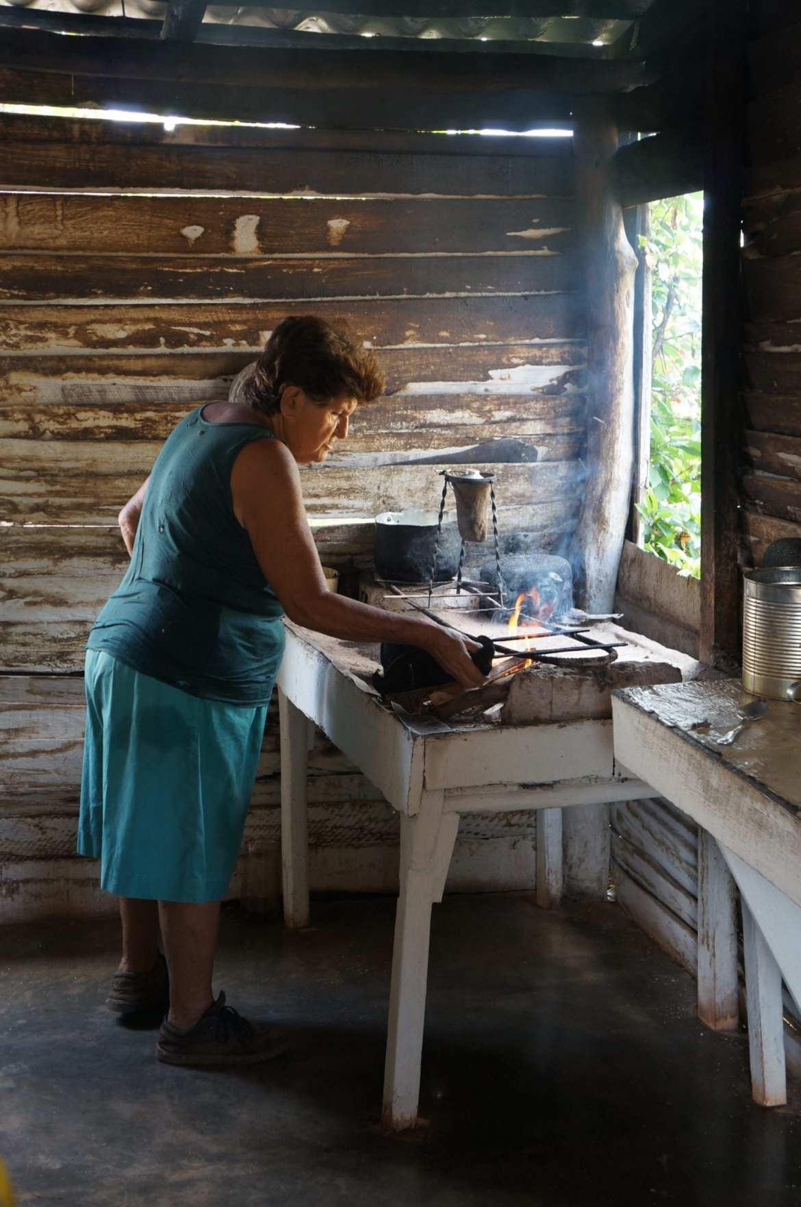 tobacco farmers wife making coffee in vinales