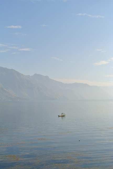 a fisherman on lake atitlan