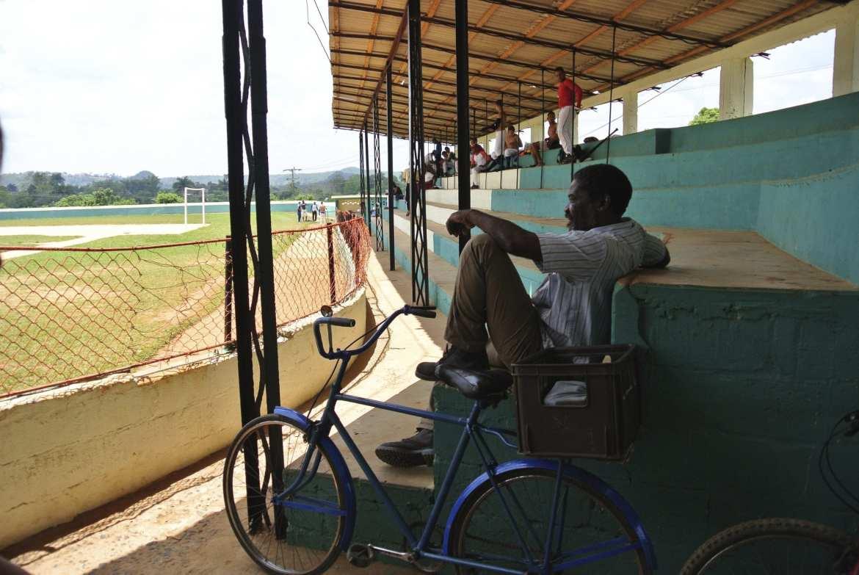 a man watching baseball in vinales, cuba