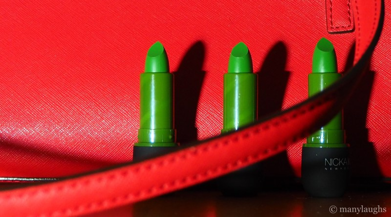 Three green lipsticks and red bag