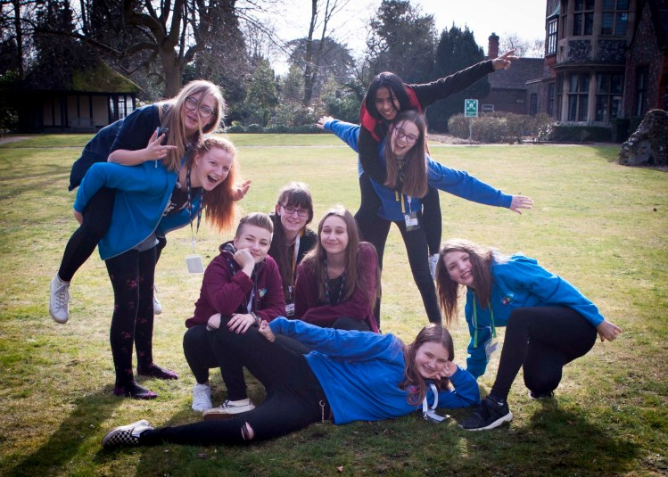 A group of young people from Broadland YAB, wearing Broadland YAB hoodies, posing and smiling.
