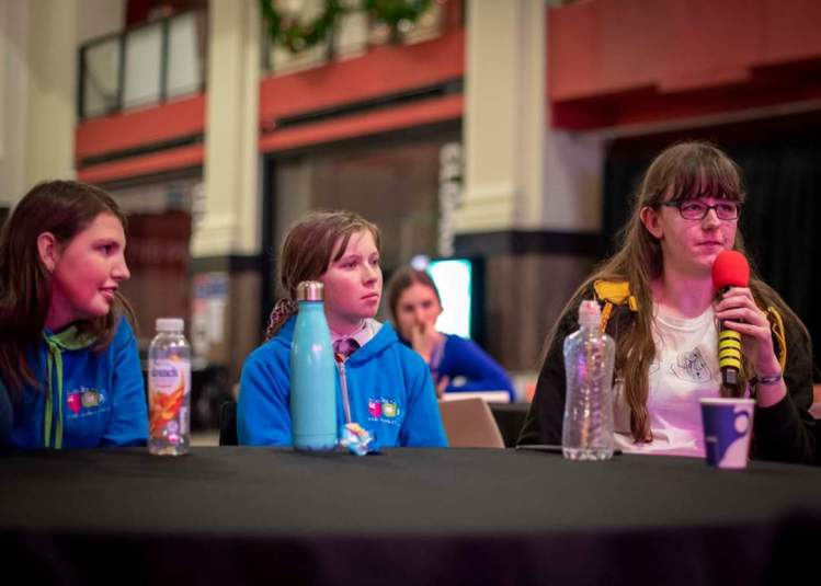 Broadland Young Commissioners speaking into a microphone.
