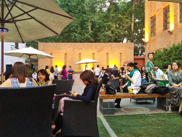 People hang out at the Grace Hotel gardens for a drink at the sun set.