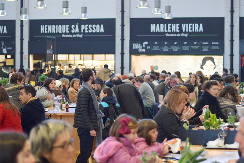 People of Lisbon Portugal eating inside Mercado da Ribeira