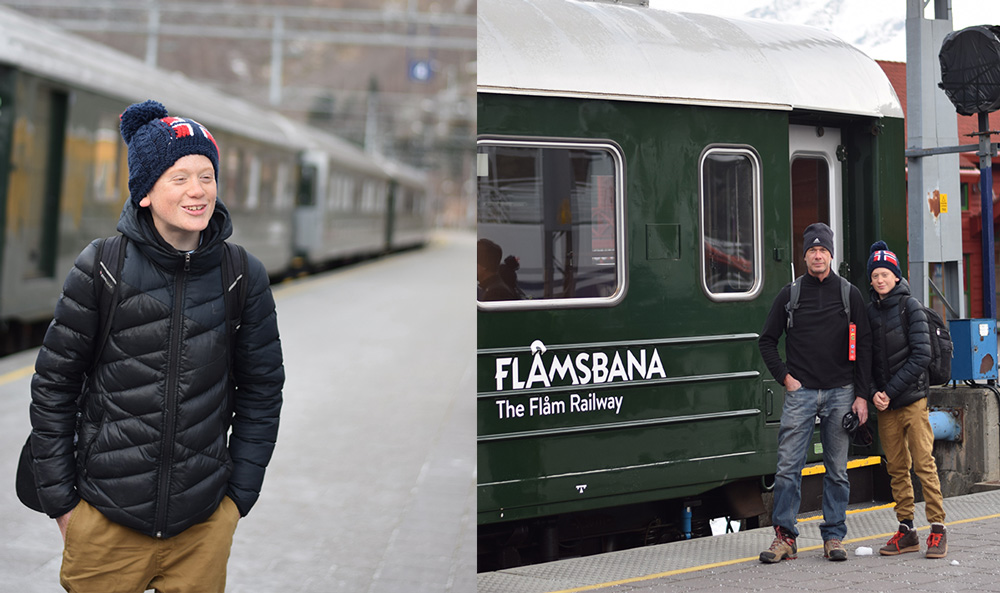 A traveling boy and a boy with his father getting on the Flam Railway in Flam, Norway