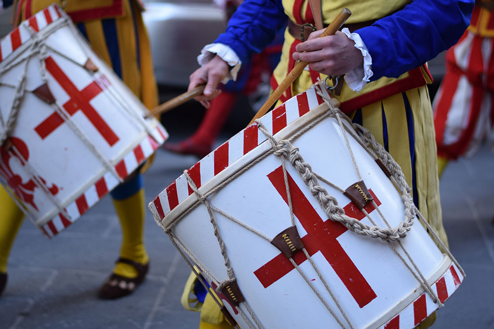 A photo of two drummers in period costume during an Easter celebration in Florence, Italy