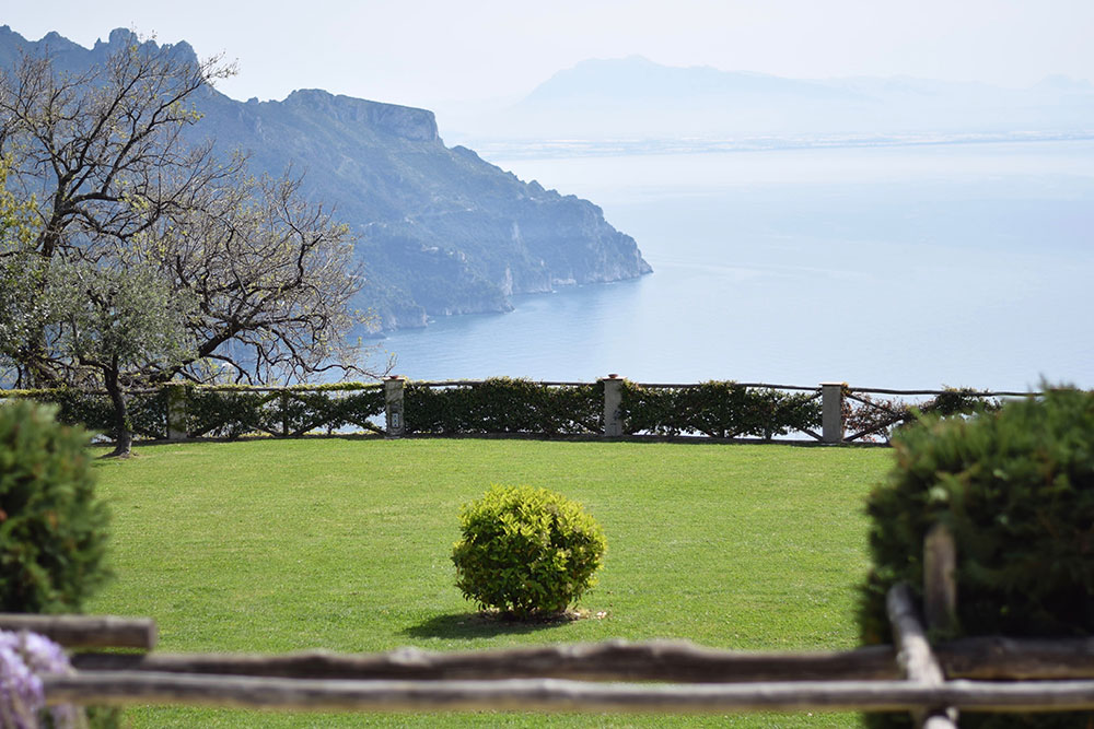 Photo of a garden with a view of the Mediterranean Sea at Villa Cimbrone in Ravello, Italy.