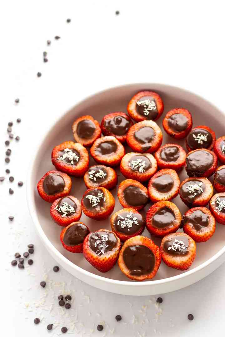 overhead photo of a bowl of strawberries filled with chocolate coconut cream