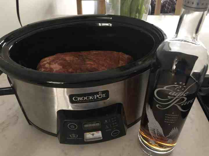 marinated pork shoulder in slow cooker with bourbon