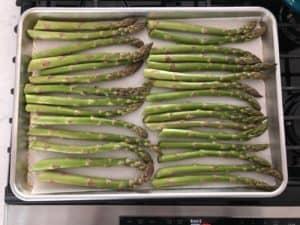trimmed asparagus on half sheet pan