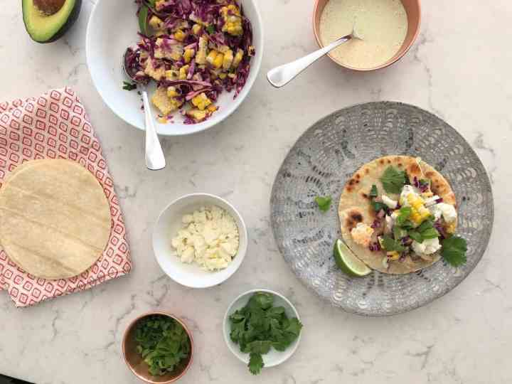 cilantro lime chicken tacos on a plate with garnishes