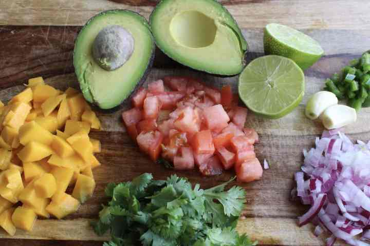 prepped ingredients for mango guacamole