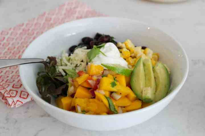 summer burrito bowl with mango salsa