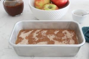 adding cinnamon sugar topping apple butter bread