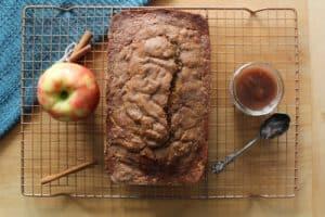 loaf of apple butter bread on maple board