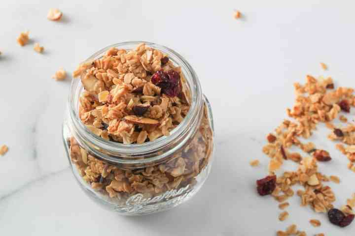 ginger cranberry granola in a glass jar