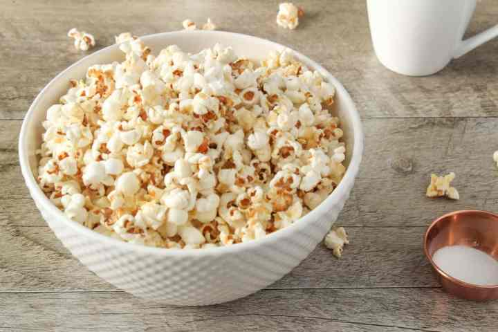 popcorn on gray wood with coffee cup
