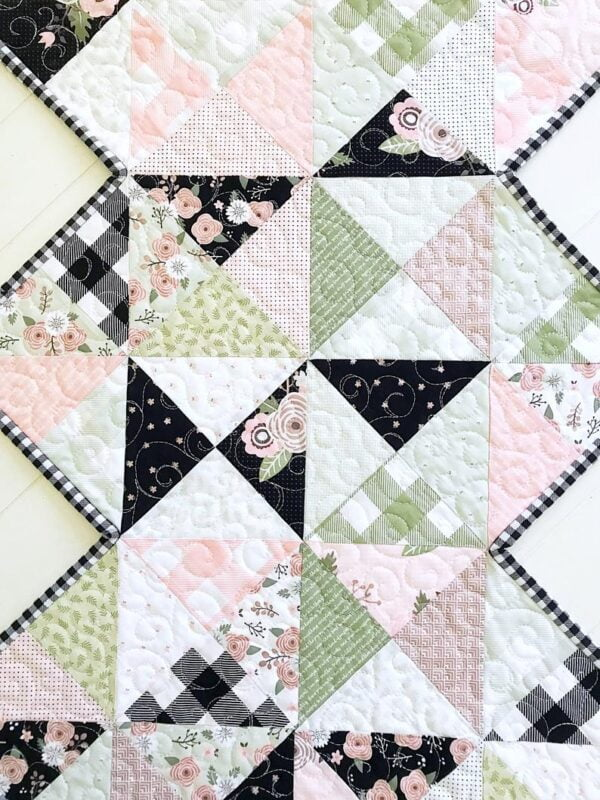 Rhapsody Whirl table runner pattern that is perfect for 1 charm pack & features a zigzag edge.