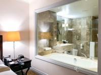 bathroom with large window into room