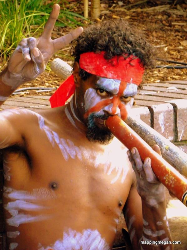Aboriginal Australian playing the Didgeridoo on Sydney Harbor.