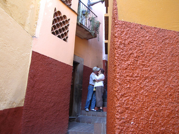 """""""Kiss alley"""" in Guanajuato, Mexico. Blogger Carole Terwilliger Meyers kissing husband Gene Meyers."""