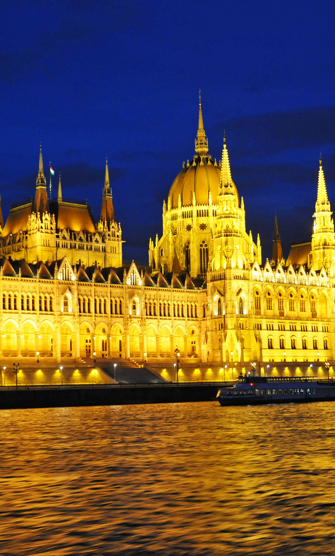 Drinking in front of the Hungarian Parliament Building in the background.